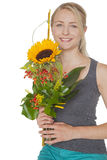 Blond woman with sunflower bouquet Royalty Free Stock Photos