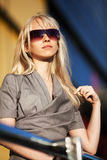 Blond woman in sunglasses Stock Photo