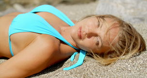 Blond Woman Suntanning on Beach with Eyes Closed stock video