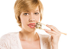 Blond woman with sushi and roll Stock Photo