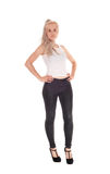 Blond woman in t-shirt and black jeans Royalty Free Stock Photography