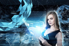 Blond woman with a tablet, polygons. Portrait of a blond woman with a tablet standing against a futuristic background with glowing polygons. Toned image mock up Stock Images