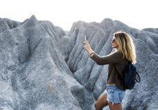 Blond woman taking photograph