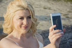 Blond woman taking selfie Royalty Free Stock Image