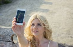 Blond woman taking selfie Royalty Free Stock Photos