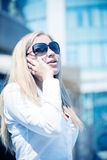 Blond woman talk by phone outdoor Royalty Free Stock Images