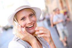 Blond woman talking on the phone Royalty Free Stock Photos