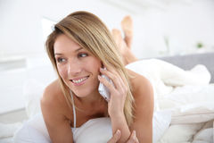 Blond woman talking on smartphone Royalty Free Stock Images