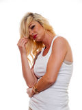 Blond woman in a tee shirt. A attractive blonde woman is wearing a tee shirt looking into the camera stock photography
