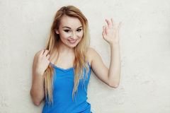 Blond woman teenage girl showing ok success hand sign Stock Photo