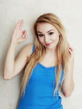 Blond woman teenage girl showing ok success hand sign Stock Photos