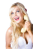 Blond woman with telephone Stock Images