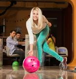 Blond woman throwing bowling ball Royalty Free Stock Photo