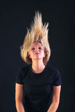 Blond woman throwing her head back Stock Photo