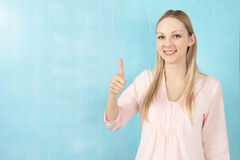 Blond woman with thumb up Royalty Free Stock Image