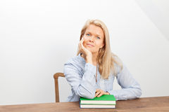 Blond woman and two books Royalty Free Stock Photo
