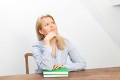 Blond woman and two books Stock Photo