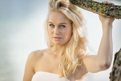 Blond woman under tree Stock Photo