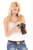 Blond woman using camera Royalty Free Stock Photo
