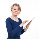 Blond woman using a touchpad Stock Photography