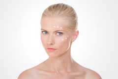 Blond woman verifies the results of her salve Royalty Free Stock Image