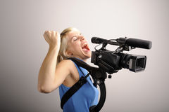 Blond woman with video camera Royalty Free Stock Photography