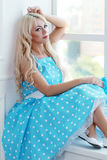 Blond woman vintage stock image