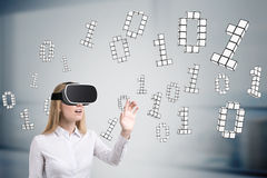 Blond woman in vr glasses, zeros and ones Stock Photography