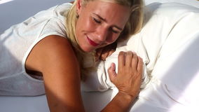 Blond woman waking up and smiles stock video footage