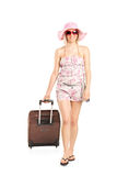 Blond woman walking with her luggage Royalty Free Stock Photo