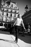 Blond woman walking in the street Royalty Free Stock Image