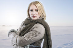 Blond woman in warm clothes over winter background Royalty Free Stock Photos