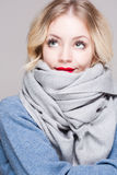 Blond woman in warm clothes. Royalty Free Stock Photos