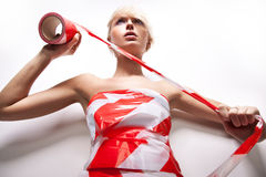 blond woman with warning tape Stock Photo