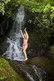 Blond woman in a waterfall Stock Photography