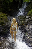 Blond woman in a waterfall Royalty Free Stock Photos