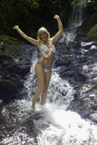 Blond woman in a waterfall Stock Image