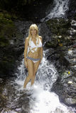 Blond woman in a waterfall Royalty Free Stock Image