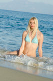 Blond woman wear bikini lying in the sea Royalty Free Stock Photo