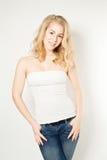 Blond woman wear blue jeans. Smiling blond woman wear blue jeans Royalty Free Stock Photo