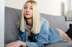 Blond woman wear  underwear sitting on the sofa Royalty Free Stock Photos