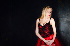Blond woman wearing beautiful long red skirt and corset Stock Photo