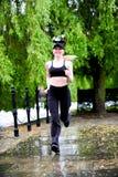 Blond woman wearing black jogging Royalty Free Stock Photos