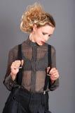 Blond woman wearing black suspenders Stock Photo