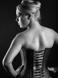 Blond woman wearing leather corset Royalty Free Stock Images