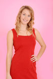 Blond woman wearing red dress Royalty Free Stock Photography