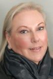 Blond woman wearing scarf smiling Stock Image