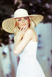 Blond Woman Wearing Sun Hat Stock Photos
