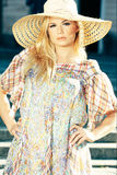 Blond Woman Wearing Sun Hat Stock Photography
