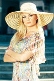 Blond Woman Wearing Sun Hat. Young Blond Woman Wearing Sun Hat Royalty Free Stock Images